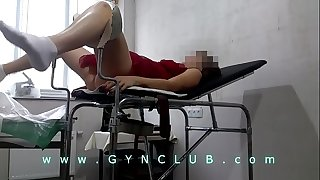 girl in red on a gynecological chair